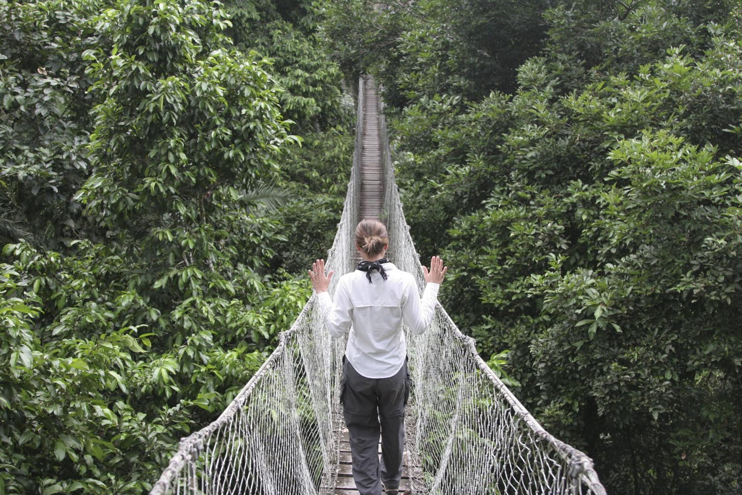 Gen Padalecki walking over rope bridge in Machu Picchu