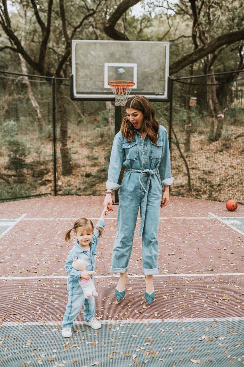 Gen and Odette in jumpsuits on a basketball field